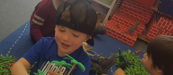 The dinosaurs are visiting Ms. Morgan J.'s classroom