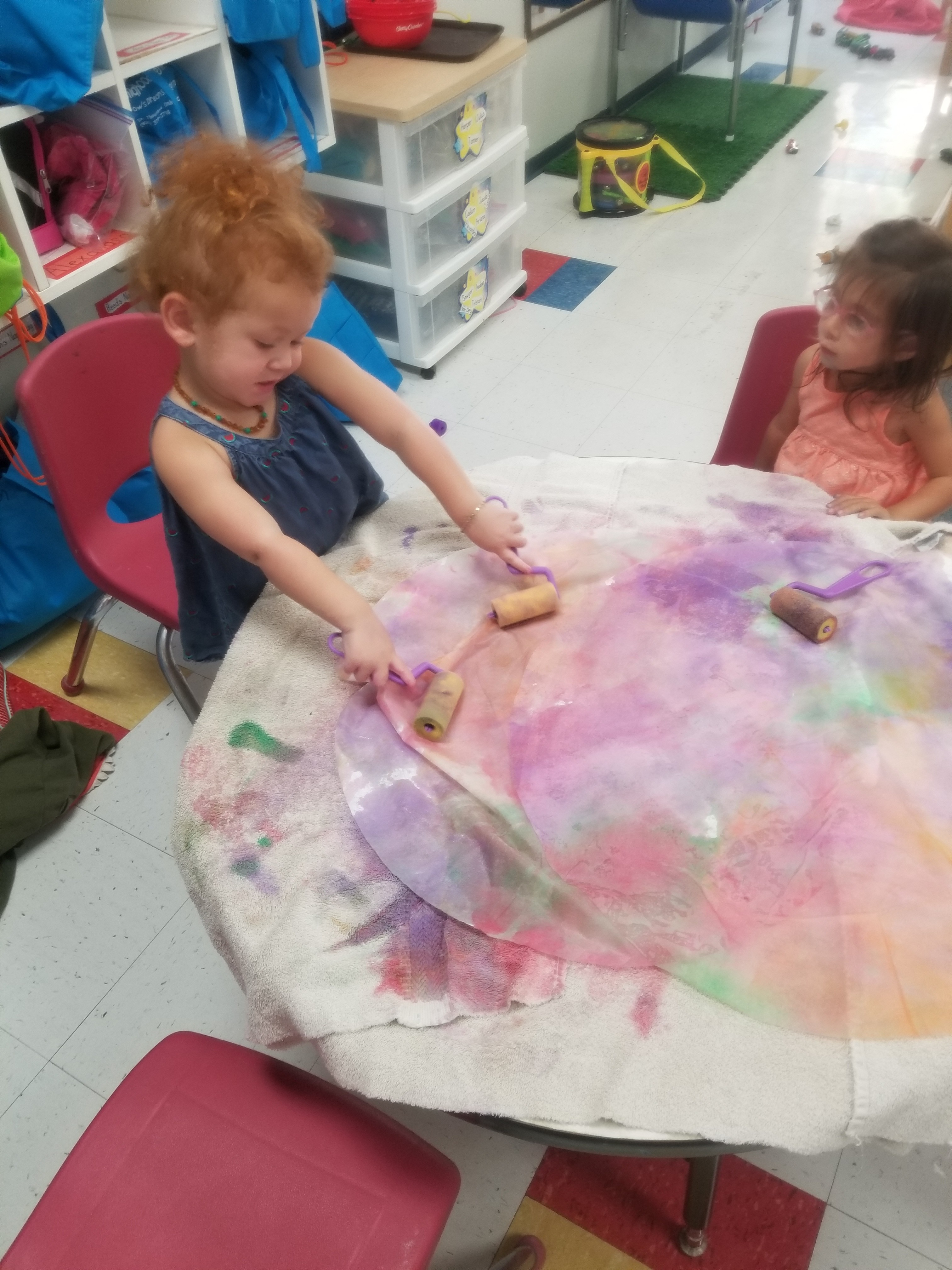 painting with paper rolls water colors big coffee filters in room