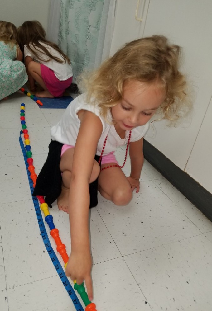 How long can this be?  Measuring in Room 2 with Ms. Tanya's friends.